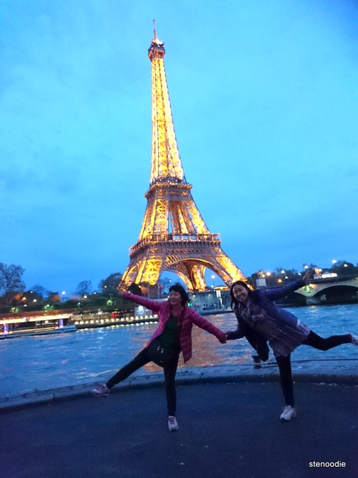 Dancing in front of the Eiffel Tower at night
