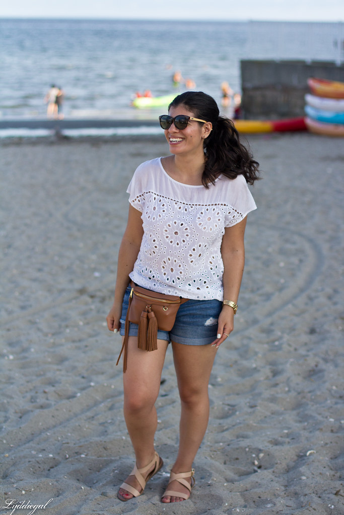 white eyelet lace blouse, denim shorts, waist bag.jpg