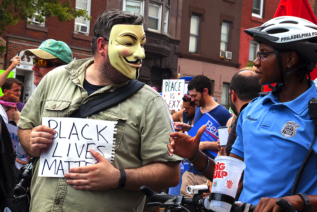 White man with BLACK LIVES MATTER sign and black cop--South Broad