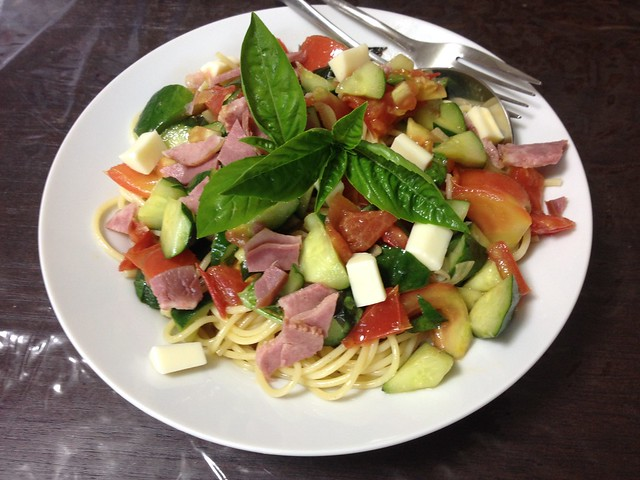 Pasta of tomato and cucumber and basilica