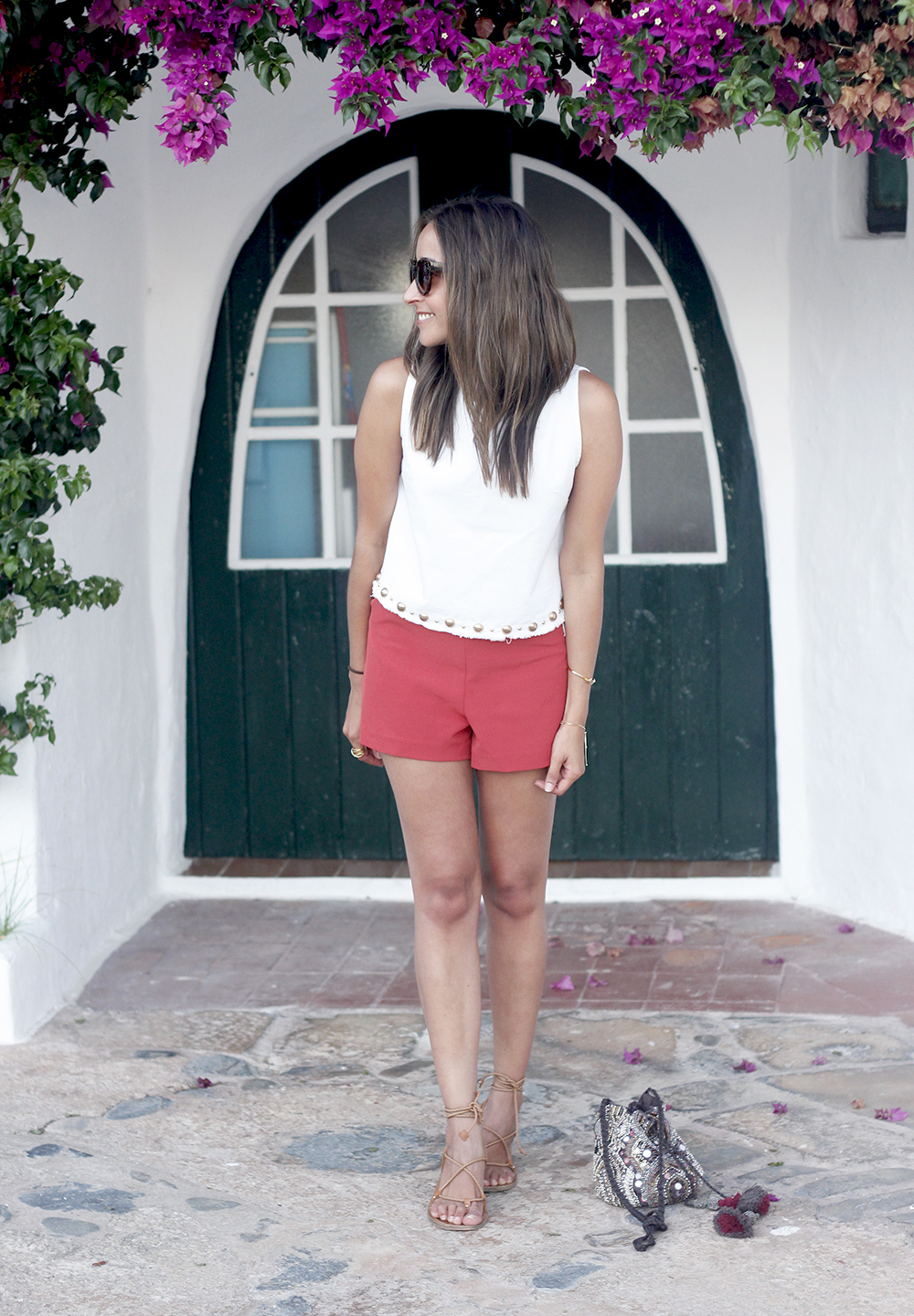 white top with shorts summer outfit flat sandals binibeca menorca12