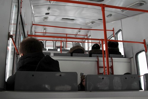 Inside the stepped passenger saloon of a carriage