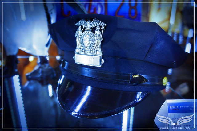 The Establishing Shot: GOTHAM CITY POLICE DEPARTMENT CAP FROM THE DARK KNIGHT RISES - PROP STORE ENTERTAINMENT LIVE AUCTION PREVIEW EXHIBITION - ODEON BFI IMAX, LONDON