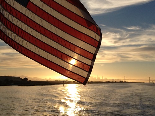 American Flag at Sunset Over San Francisco and the Bay Bridge