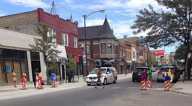 04 Susan Krueger-Barber Pinatas in place in crosswalk at Drake and Milwaukee as traffic calmers 080716