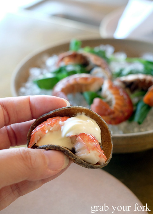 Red claw yabbies with lemon jam and cultured cream in a buckwheat pikelet at Bennelong Restaurant Sydney