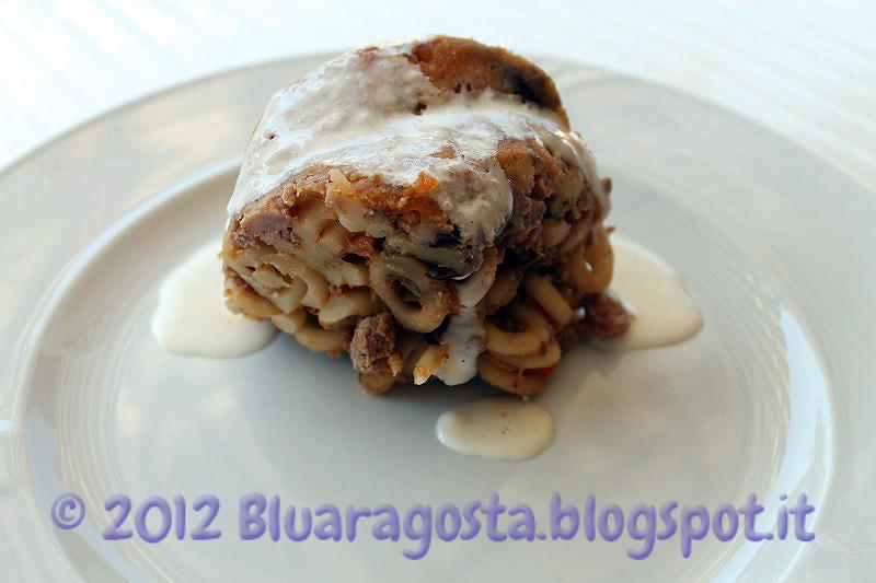 07-timballo di anelletti con fonduta al parmigiano