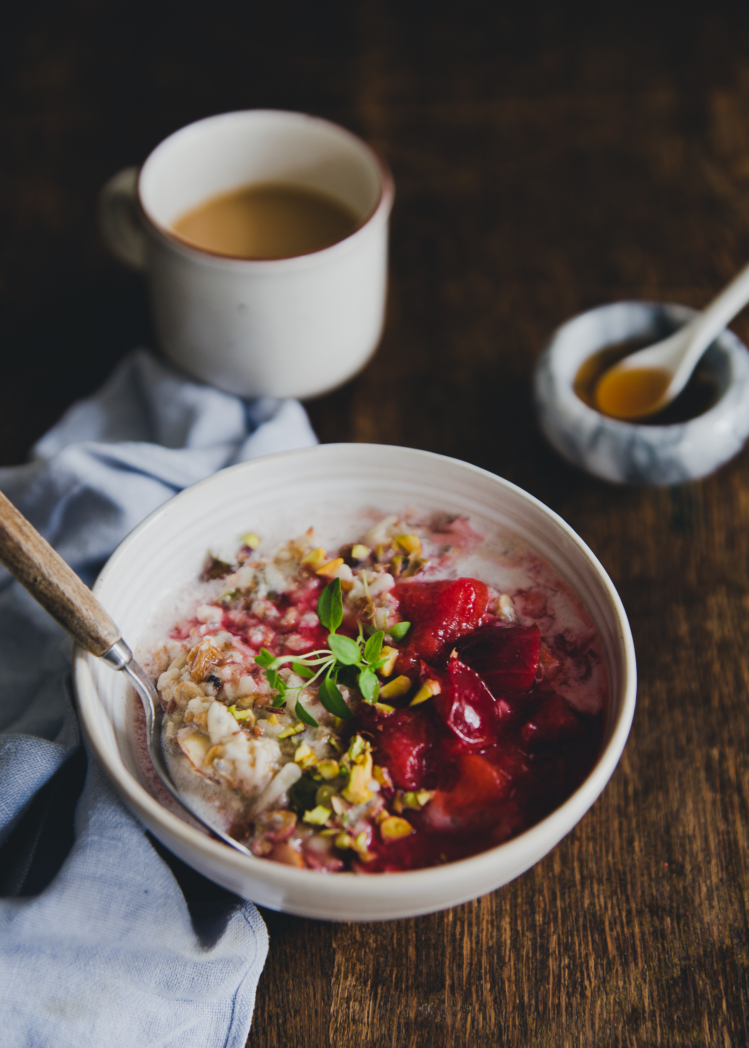 Bircher Muesli with Warm Plums & Spruce Syrup | Cashew Kitchen