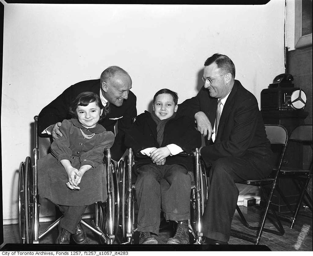 Conn Smythe with children in wheelchairs