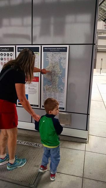 Benji and Ellen look at a light rail map