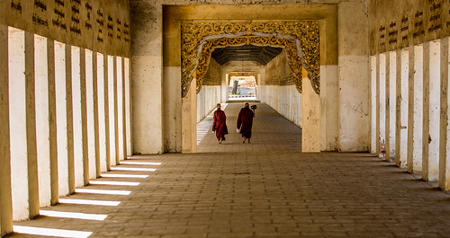 Two monks walking, not carrying the ricebowl like everyone does