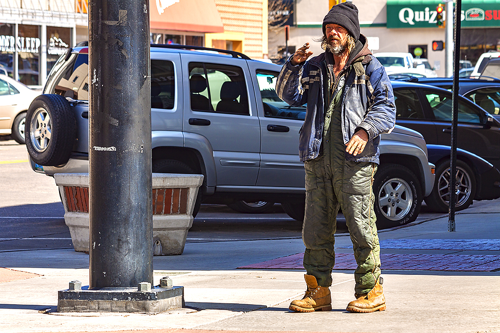 Smoking-man-in-black-knit-cap--Cheyenne