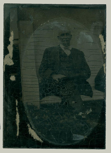 Oval portrait of a seated  man