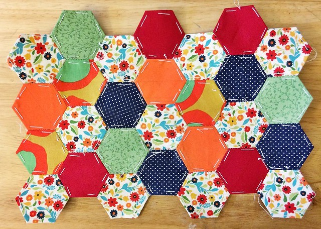 I may be the self proclaimed (and perhaps lapsed) Yo-Yo Queen, but these are my very first attempt at hexies. My mom has been making hexies like crazy for a while now and I see the appeal. I love that you can piece a huge variety of fabrics together. This