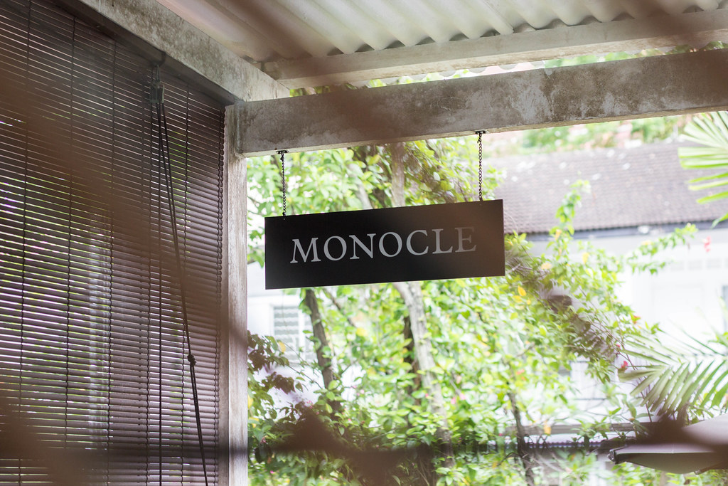 Monocle Cafe Sign