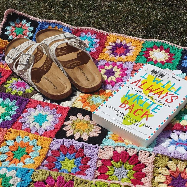 thanks @lululoves_uk for asking #widn I'm enjoying a little bit of sun and a new book while my kids are at the youth program in the park. #bookstagram #crochetgirlgang