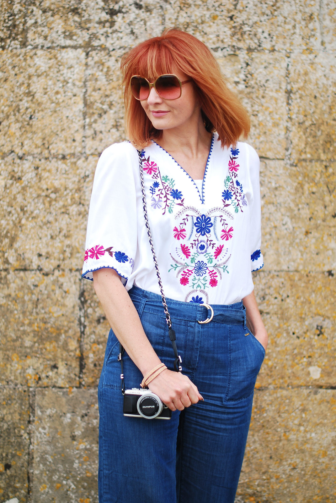 Embroidery and denim: Greek-style embroidered top, wide leg jeans, red lace-up espadrilles | Broadway Tower, The Cotswolds | Not Dressed As Lamb