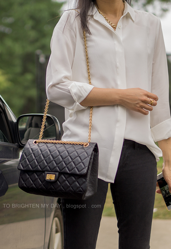 white silk boyfriend shirt, gold jewelry, black jeans, black shoulder bag