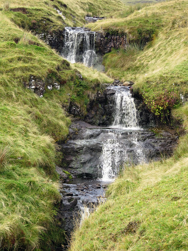 A cascade of waterfalls in a stream in the Antrim Glens, Ireland, UK
