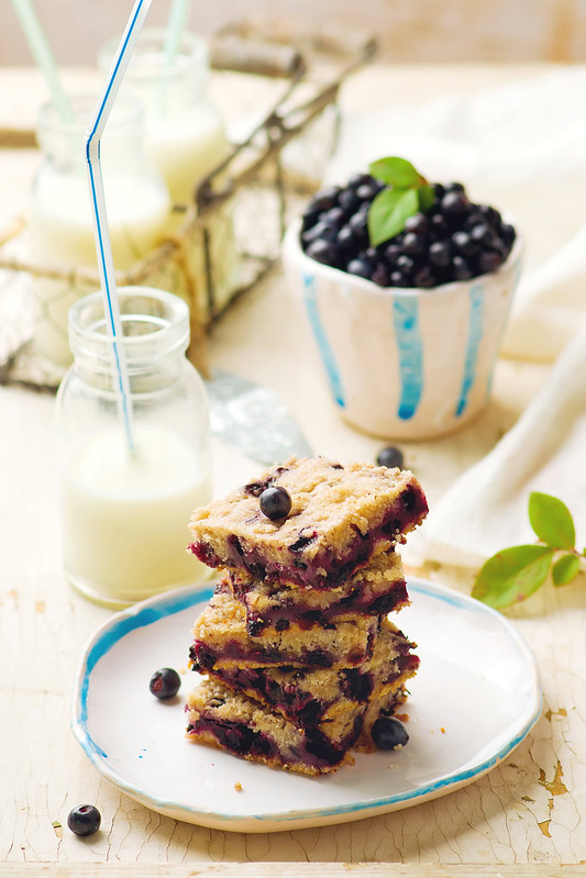 Blueberry cake and bottle of milk .