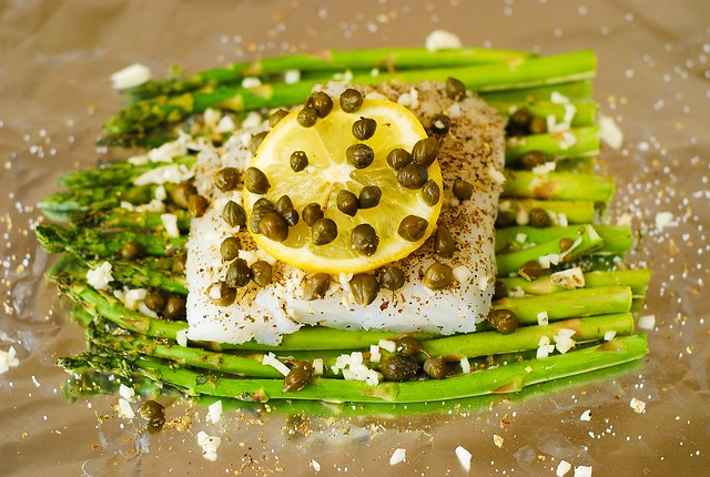 Baked cod and asparagus in garlic lemon caper sauce in for Lemon butter caper sauce for fish
