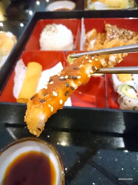 Chopstick holding up pork katsu