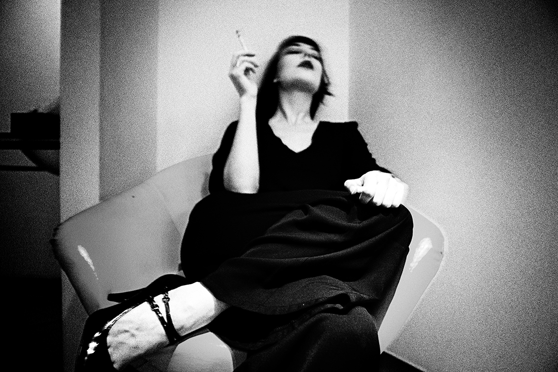 Gestalta photographed by Yu. grainy black and white images of a girl smoking in a hotel room