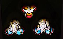 Dove descending between angels