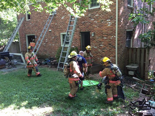 various photos from scene of house fire showing damage, firefighters and fire trucks